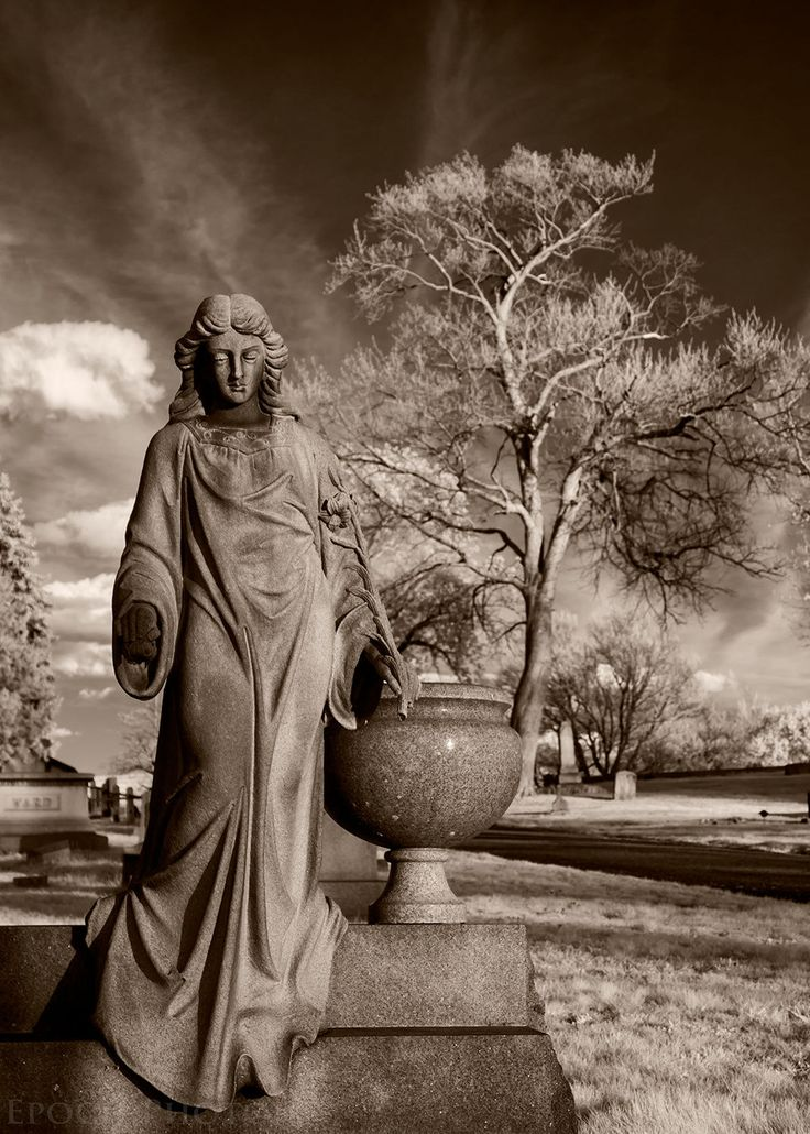 Blessed Be The Mourners... by Bob Vishneski on 500px.  The thing that I like the most about Vishneski's graveyard pictures is that he is able to capture both landscapes and sculptures in the same frame, and not have one overpower the other, but instead compliment each other.