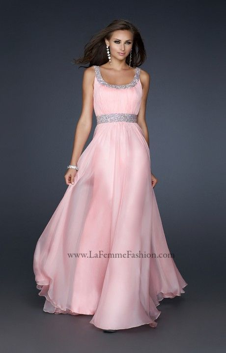 This soft and feminine Prom dress is the LaFemme 17473! The simple yet elegant design is perfect for all kinds of body types and sizes! The scoop neckline is super flattering and brings out the sparkle in the straps and belted waistline! The ruching that covers the bodice is very flattering and elongates your body! Poly Chiffon flows while you dance the night away in this La Femme dress in lots of colors to choose from!