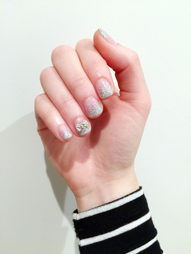 Glittery wedding nails with a bow detail.