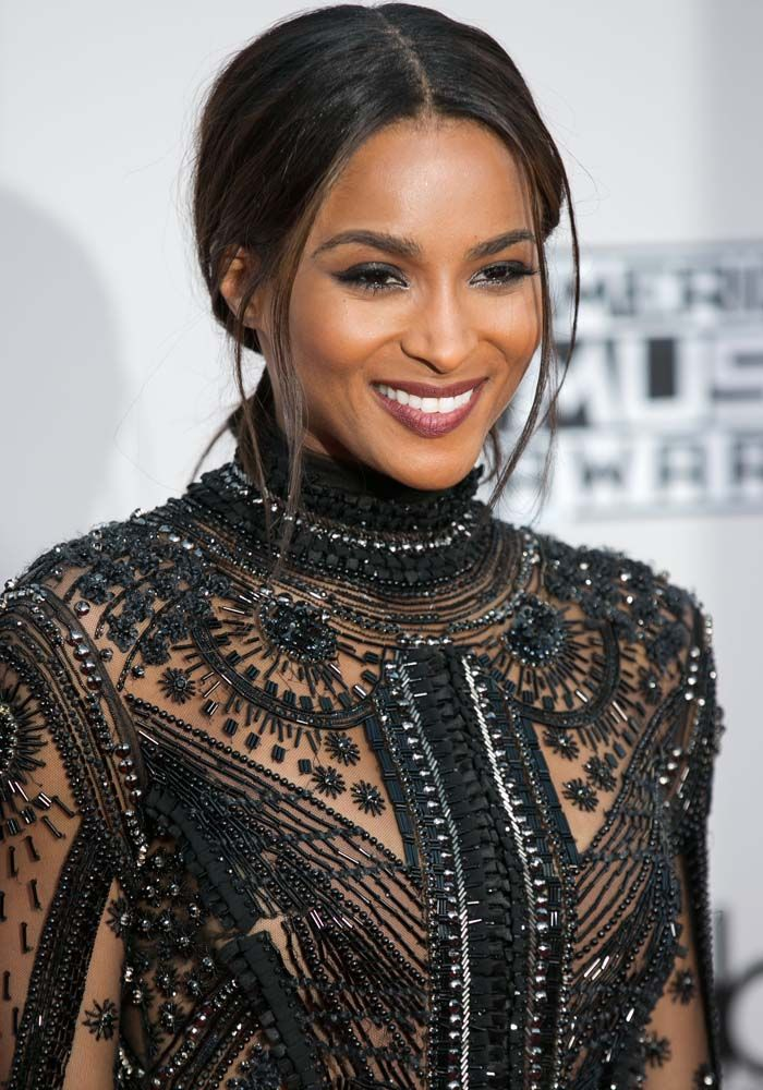 Ciara Keeps Herself Updated on NFL Boyfriend's Game During the AMAs in Stuart Weitzman