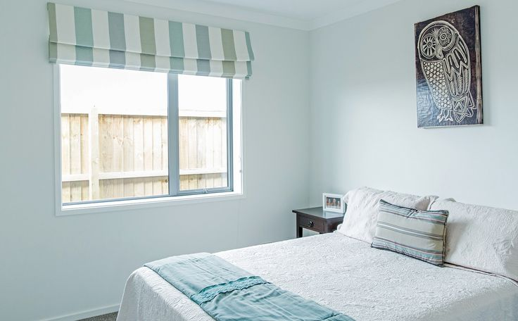 Spare room. A nice use of roman blinds.