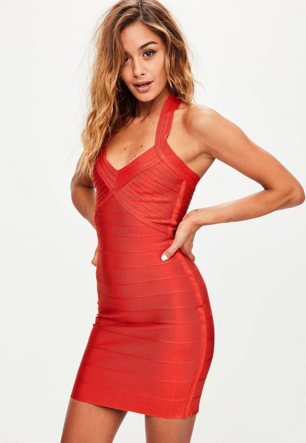 Red bandage dress featuring a halterneck, bodycon fit, ribbed fabric and mini length.