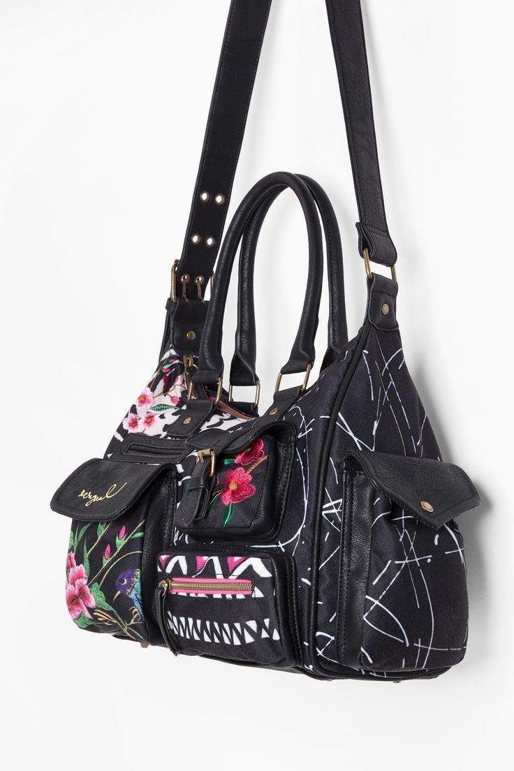 This bag from Desigual's Spring/Summer collecton measures 32 x 12 x 25.5 cm. It's inspired by boho and hippie trends and is adorned with embroidered flowers. It's on sale now, so hurry!