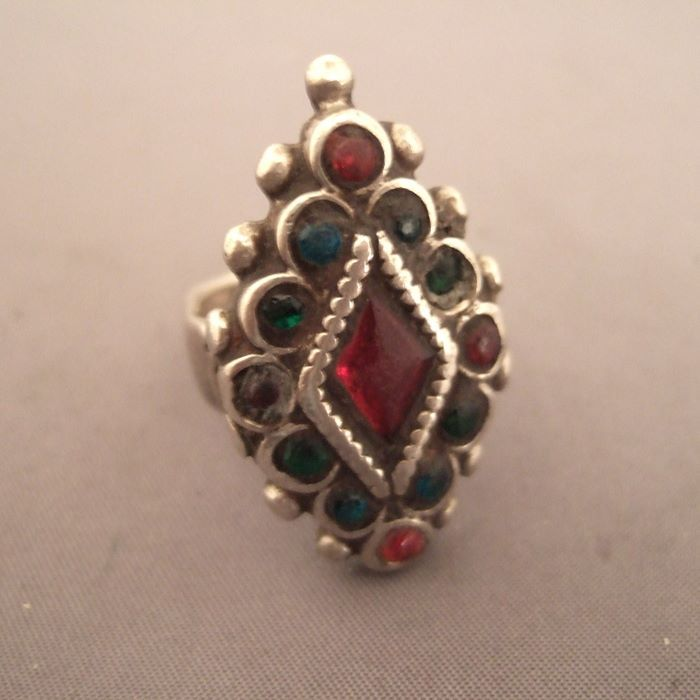 Silver, glass beads, Afghanistan and Pakistan   Description :  A fairyland of colored glass beads for this old ring of nomadic woman, the whole set forming a beautiful floral design ...  Size:8 adaptable  Weight:17,75gr  Still for sale in my shop at 28, Galerie du Roi at 1000 Brussels ...