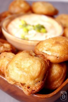 Amazing beer-battered fried pickles with sriracha dipping sauce