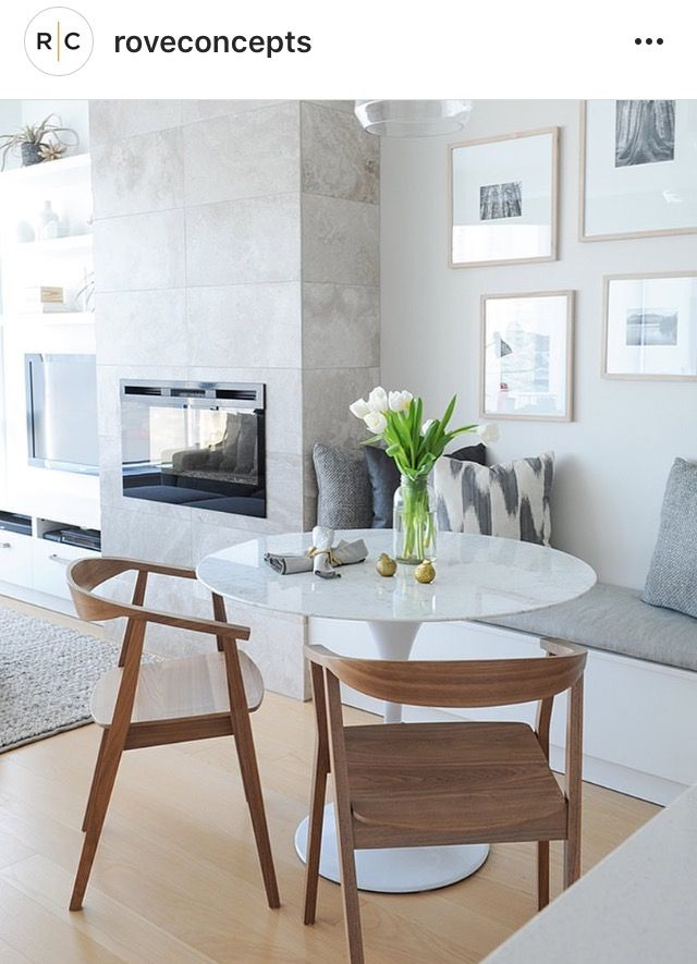 Simple breakfast nook - chairs, table , gallery wall,