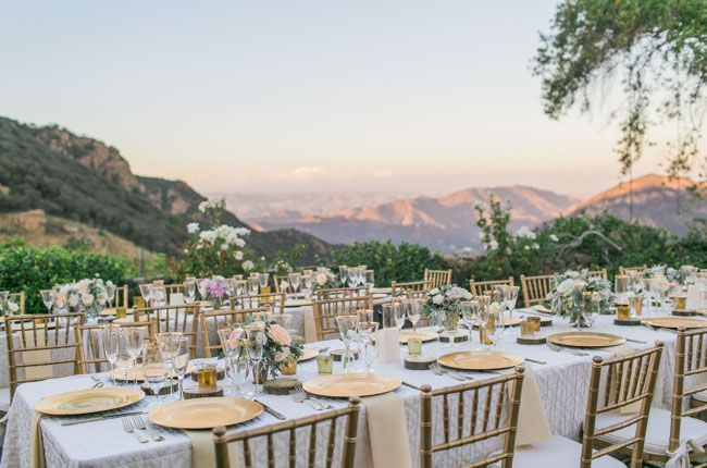 Malibu reception view of sunset + gold tablescape details