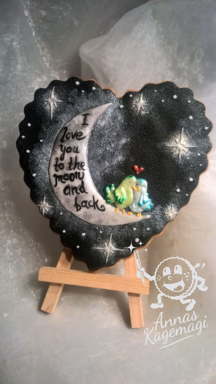 Love birds on the moon. Sugar cookie with black marzipan decorated with royal icing.