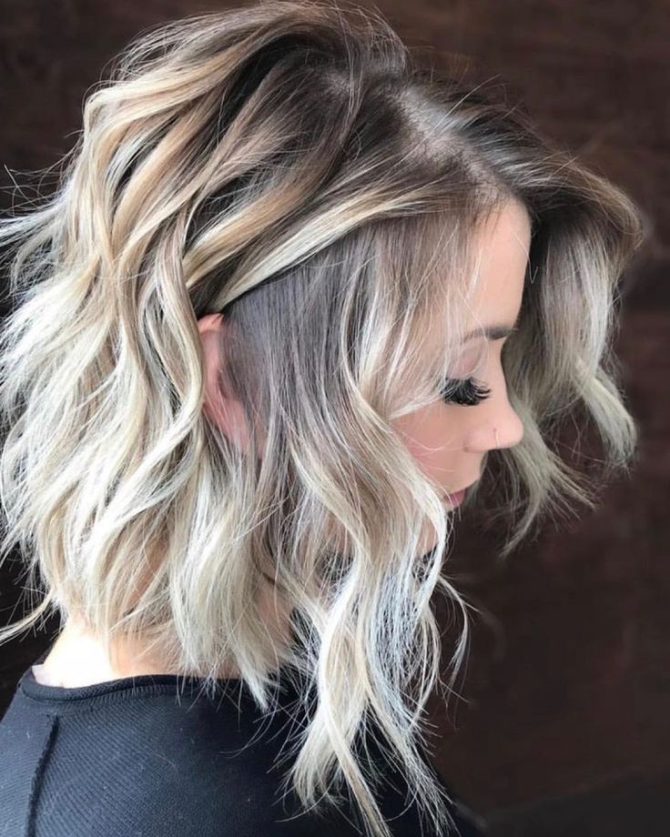 Dimensional cool-toned blonde balayage with beautiful soft, messy beach waves.