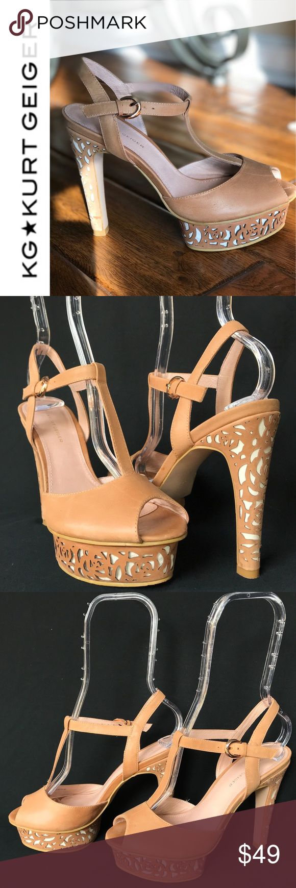 KG Kurt Geiger Peep Toe Platform Heel Sz 37 Rare KG Kurt Geiger Camel Tan Peep Toe heels Tan & White Floral Platform Sz 37 US 7 Very unique Leather KG Kurt Geiger peep toe heels that are in lightly used condition. Intricate floral design on the front platform as well as the heel of the shoe. Made with a tan/caramel leather. T-strap design that lies nicely on the top of the foot. Gold tone buckle closure for fastening. Salmon colored interior with light mark from sole insert removal. Please…