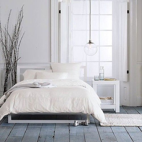 West Elm / bedroom / floor / white / plant / decor / lighting / lamp / scandinavian
