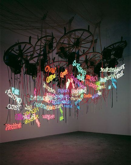 Twelve-Wheel Waggon Wheel Chandelier by artist Jason Rhoades