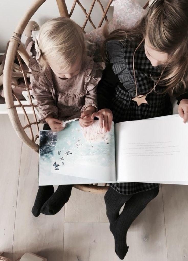 Sweet little angels in London reading about  The Hidden Kingdom { a Great Barrier Reef adventure }