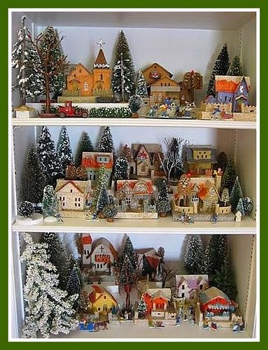 Christmas Village Shelves! Put some blue lights behind the trees and at night this would just glow :) great way to save space for large villages