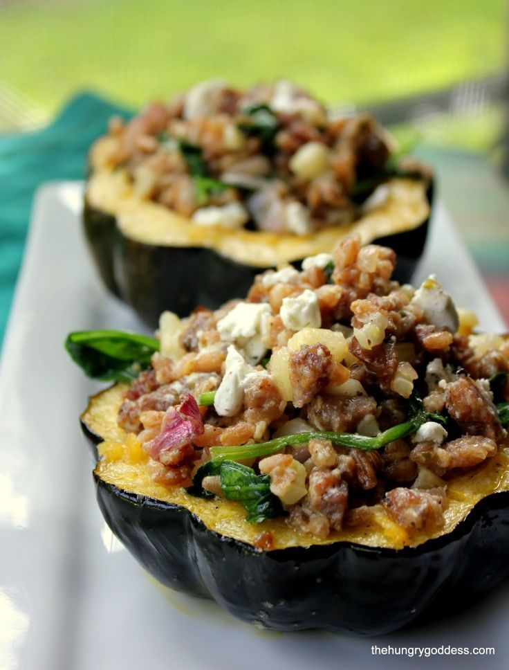 Roasted Acorn Squash Stuffed with Fennel Sausage. Farro. Goat Cheese and Spinach