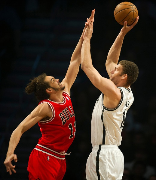 Brooklyn Nets Brook Lopez (11) gets a shot off over Chicago Bulls Joakim Noah (13) during game two of their first round NBA playoff game April 22, 2013 at the Barclay Center in New York. DON EMMERT/AFP/Getty Images