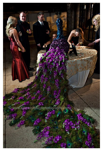 The place card table will feature a gorgeous peacock made of fresh green moss, purple stock flowers, and purple and blue hydrangeas with peacock feathers.  A dramatic piece that will make a statement!!