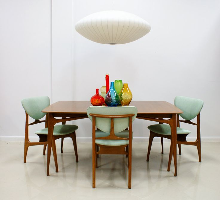 Love this 60s style table and chairs and the space ship light!
