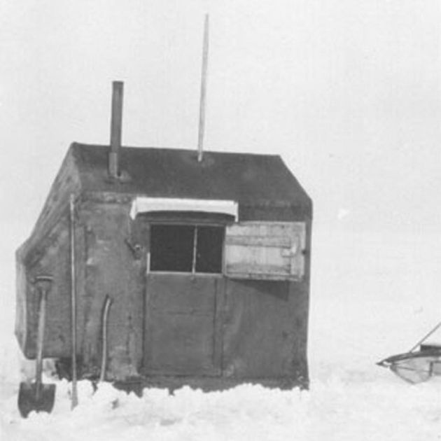note the pole sticking out the roof - a hole  was cut in the roof so anglers could spear fish - vintage picture from Lake Simcoe, Onario