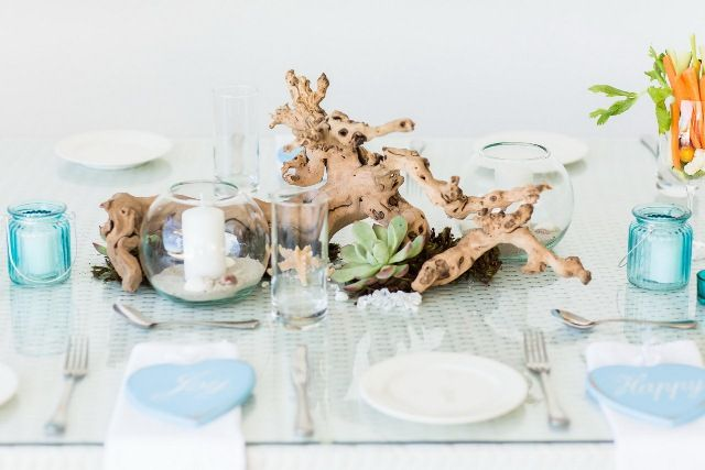 Driftwood centre piece, beach theme, blue, white, succulents, shells, star fish, candles, Camps Bay, Cape Town.