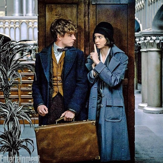 Where's an invisibility cloak when you need one? Newt Scamander & Tina Goldstein take cover while sneaking around MACUSA (the Magical Congress of the USA) in this NEW photo from @fantasticbeastsmovie! ✨ Have your wands at the ready because #FantasticBeastsAreComing to our Fall Movie Preview cover (on newsstands August 12th)—and we have more scoop on the film each day for the next week and a half!