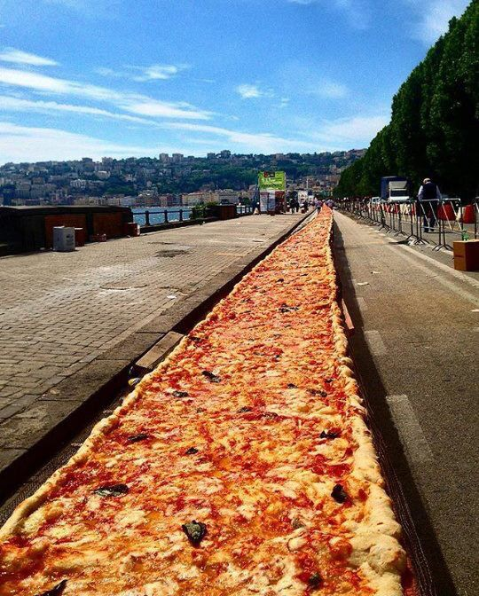 Longest pizza in the world. Of course it was made in Napoli.