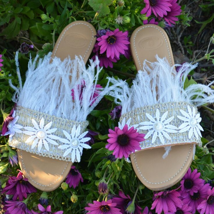 "Feathers, pearls and daisies on our dreamy ""Plumette"" slides"