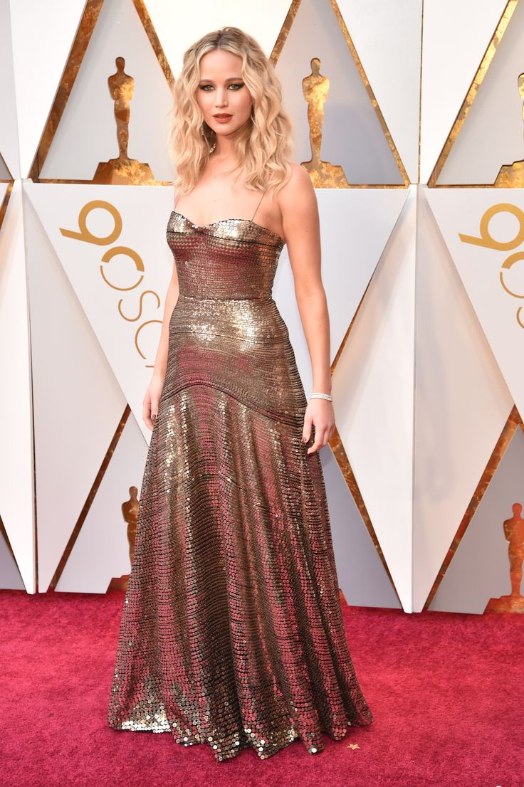Jennifer Lawrence slays in stunning gold strapless sequin gown  for Christian Dior on the Oscar Red Carpet.