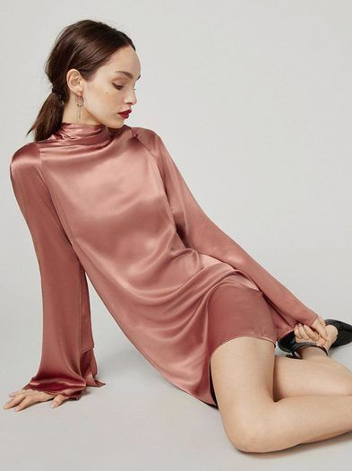 Dresses to wear while you scroll instagram in the corner of the party. This is a mini length dress with an open back and a mock neck.http://bit.ly/2hMYEt7