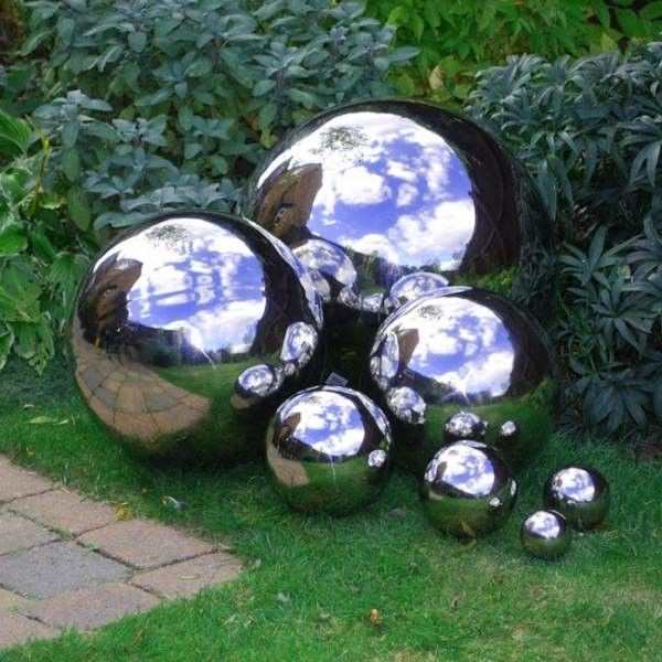 "Use some <a href=""http://www.thegardenglove.com/how-to-make-mirrored-gazing-balls-for-the-garden/"" target=""_blank"">chrome metallic spray paint</a> to make bowling balls into reflective garden orbs."