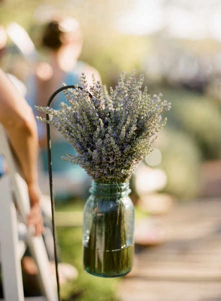 (lavender)  Hey we can have small herb bouquets, with any fresh herbs to smell nice and kind of vintage looking too all down the aisle chairs indoors.