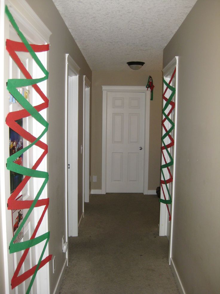 """December 6, 2014 ~ Sparky """"decorated"""" the kids bedroom doors with streamers..."""