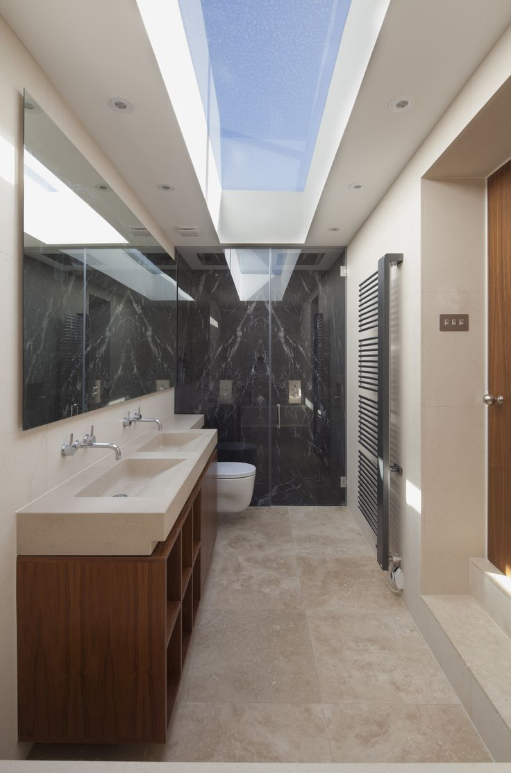 Love the sky light in the bathroom idea