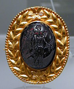 Magnus's ring depicts the goddess Victoria, as does this ancient Roman ring.  Gold, with a carved garnet intaglio, this gem is on display in Rome's Palazzo Massimo.
