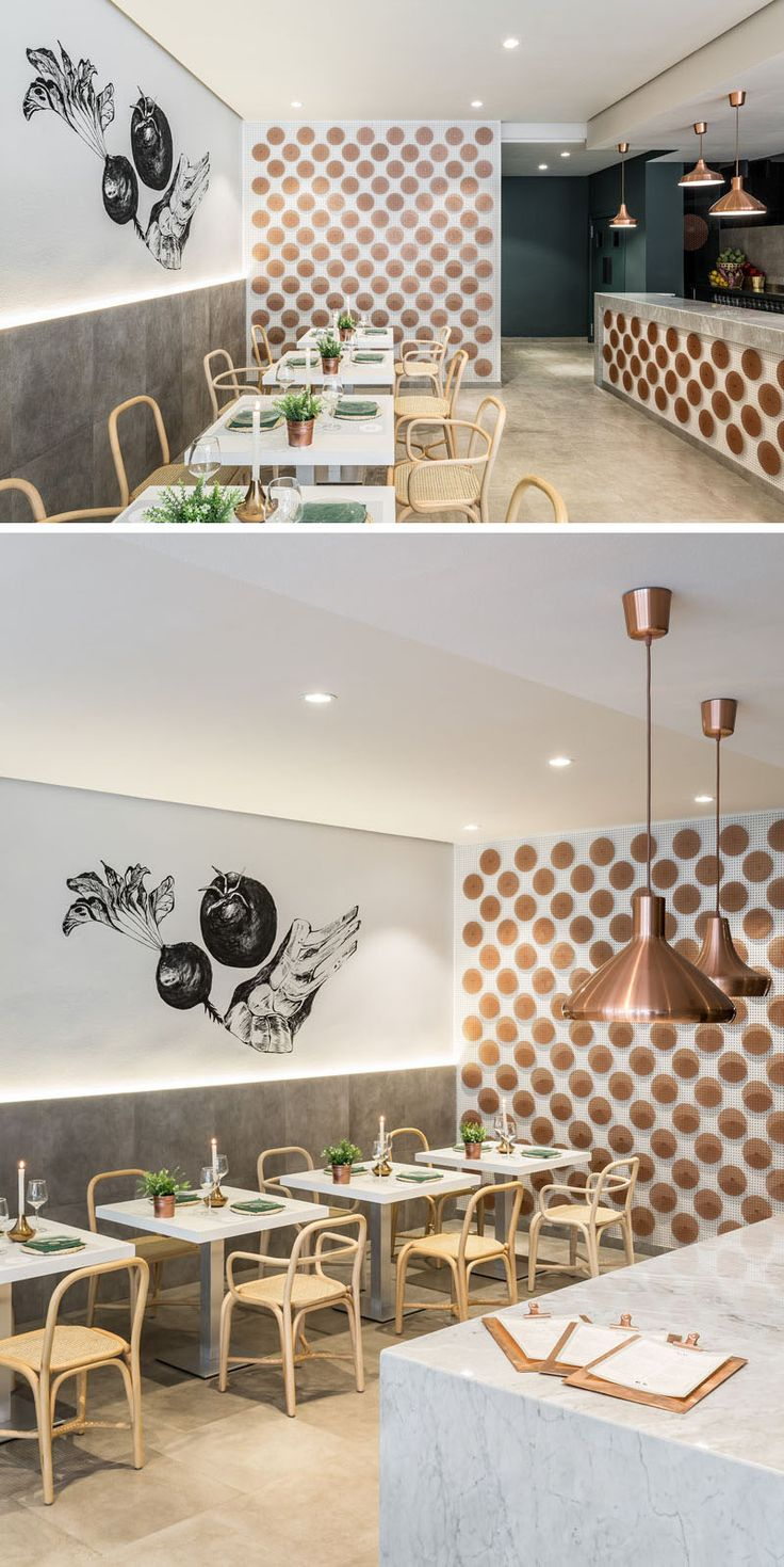 Over 200 perforated copper discs cover the wall and the front of the open kitchen in this restaurant.