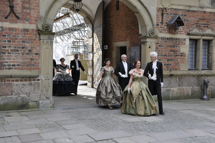 Dancers entering the castle courtyard in wonderful dresses - ready to perform 19th century dances in The Great Hall