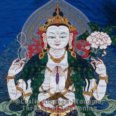 http://www.tafalist.com/members/leslie-rinchen-wongmo    Silk appliqued thangka by artist Leslie Rinchen Wongmo.  She trained in Tibet and uses traditional methods although often interprets Tibetan culture through her own eyes.  This is Chenrezig, a Tibetan Buddhist deity, Bodhisattva of Compassion.