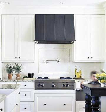 such a pretty kitchen nice choice in materials love the range hood