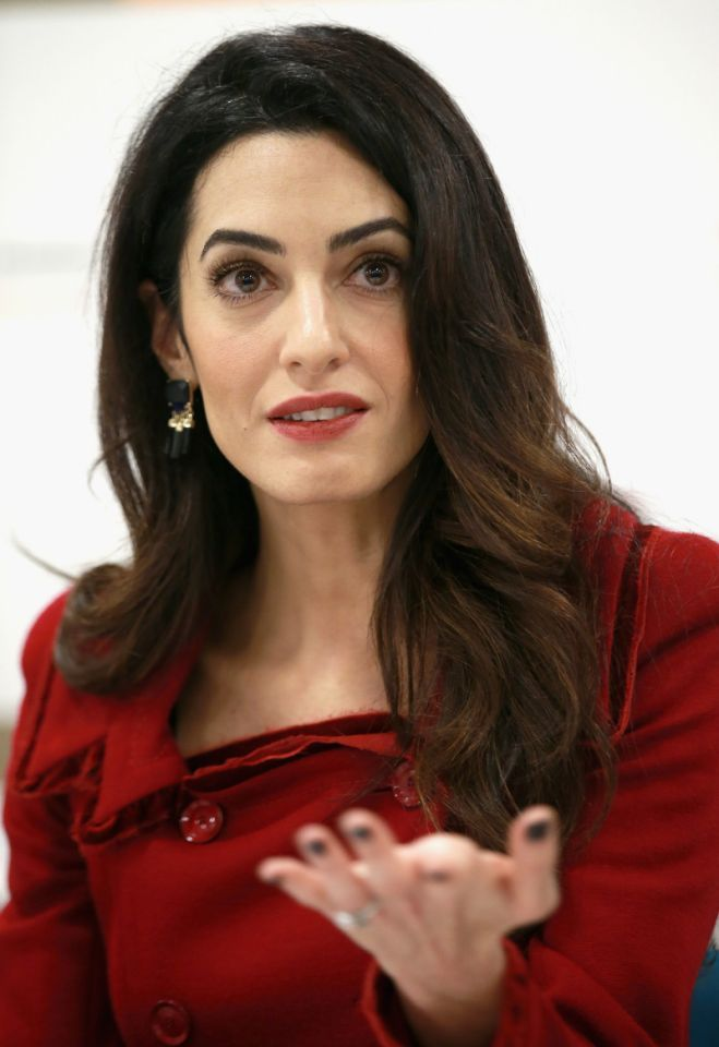 <p>At a press conference following her big win, Amal Clooney wore a beautiful textured blazer. She wore the double-breasted red piece with a matching skirt to brief the world on her win to free former Maldives President Mohamed Nasheed from jail. <i>Photo: Getty Images</i><br /></p>