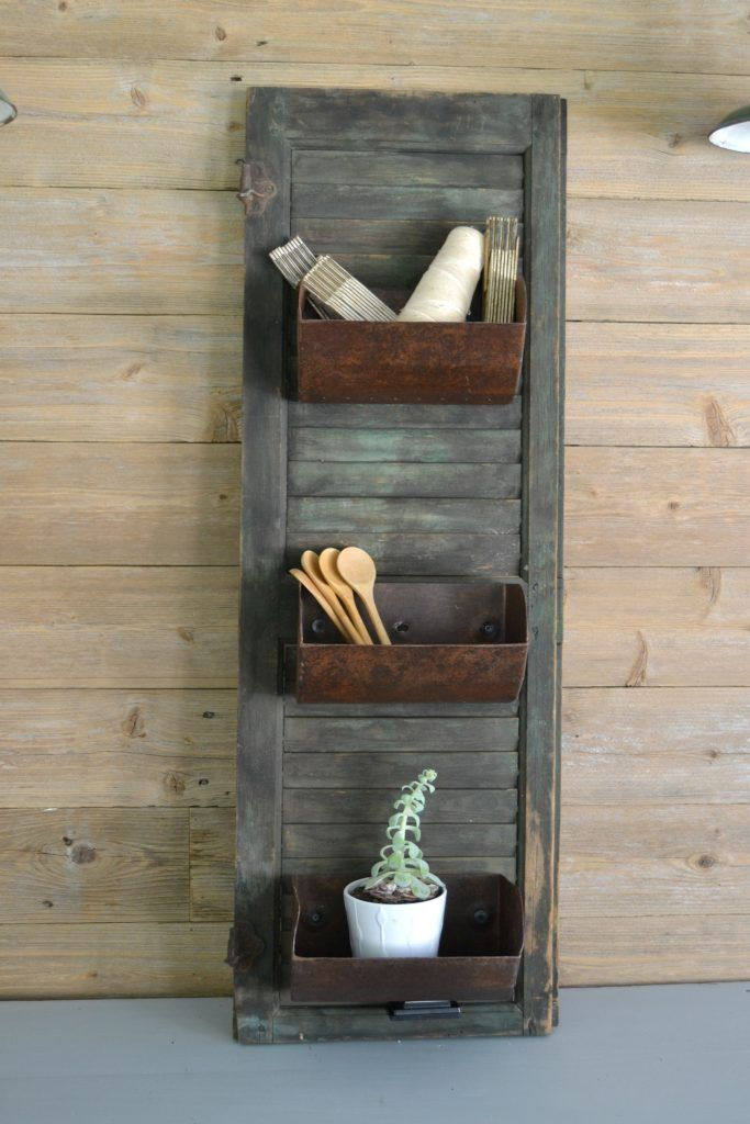 Farmhouse Storage shutter with grain bin storage.  maybe old loaf pans?