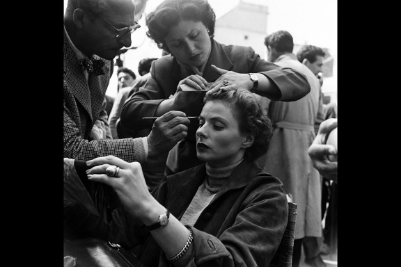 Swedish film star Ingrid Bergman has her hair and makeup done in preparation for a scene at Cinecittà in 1953.