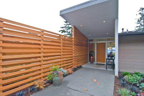 Continuous indoor outdoor walls aesthetics cedar walls for Indoor fence design