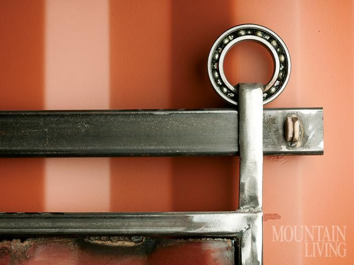 interior door latch, industrial steel bearing, sliding door, industrial design, recycled shipping container, mountain home, green home. PHOTO by Branden Gunem MORE INFO at http://mountainliving.com/article/rockin'-hard-place