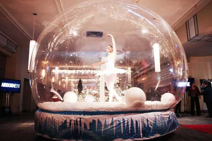 Guests were greeted in the Grand Foyer by a ballerina dancing in a blow-up snow globe - Event design by McNabb Roick Events
