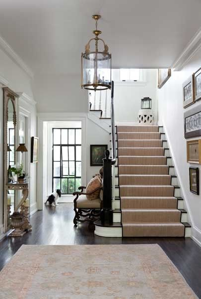 Great entry rug paired with sisal style stair runner