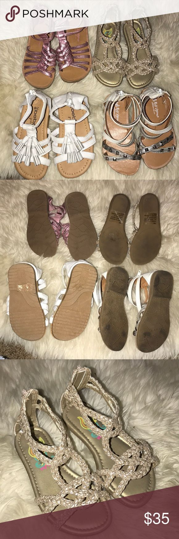 Lot of 4 toddler sandals size 7 Lot of four toddler sandals all size 7. The bebe ones have never been worn, brand new. The other ones are lightly worn and in great shape. They are all so adorable, steal of a deal for your princess! bebe Shoes Sandals & Flip Flops