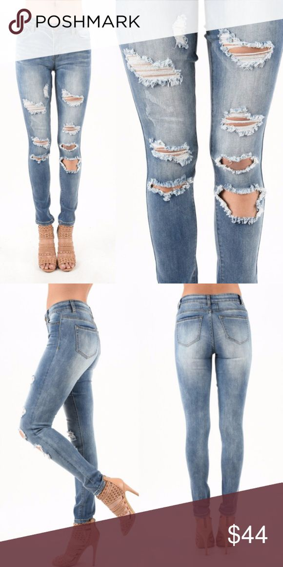 """Distressed Stretch Skinny Jeans in Light Blue Wash Stretch skinny jeans with a distressed or some call destroyed look.  Fits true to size.  5 pocket style with 33"""" inseam.  Only one of each of the remaining sizes are left. LA Design Jeans Skinny"""