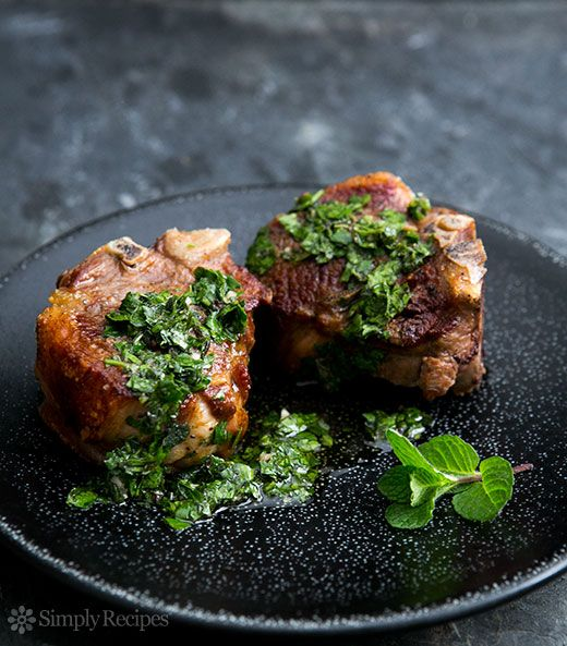 Seared lamb loin chops, served with chimichurri sauce of mint and parsley. ~ SimplyRecipes.com