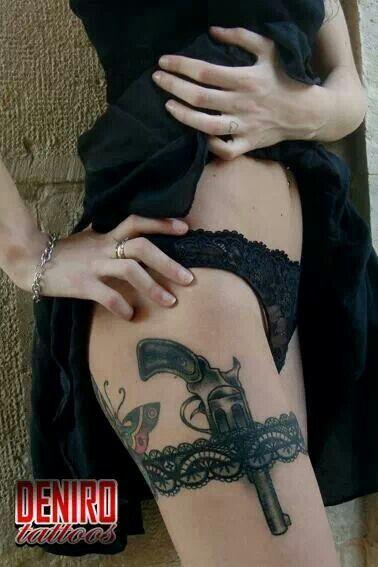Garter belt revolver tattoo