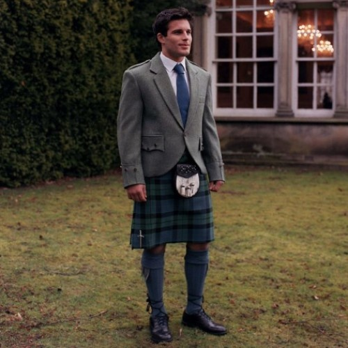 Grey tweed jacket with kilt but would have black socks. Tie to match theme yellow or blue